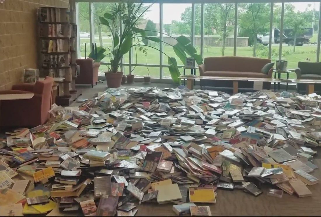 Pile of books on a library floor